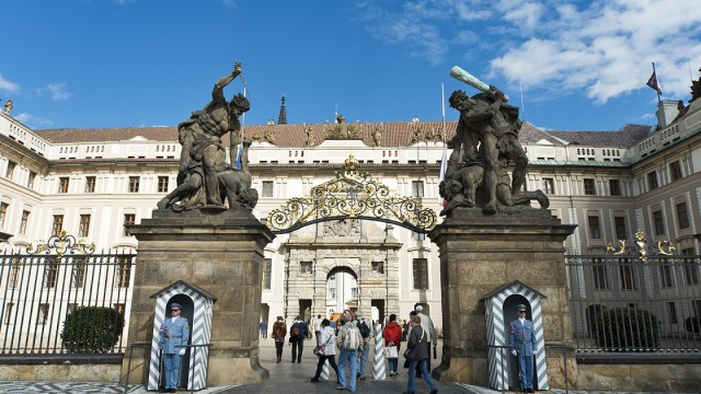 A photo of the outside of Prague castle showing two statues.