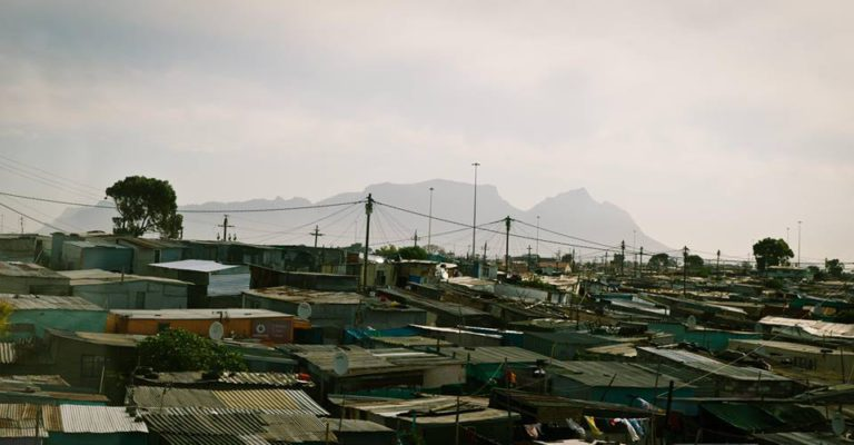 A photo of shacks and informal settlements in Khayelitsha in Cape Town, South Africa. the Future of South Africa