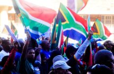 A group of protesting people against threats facing South Africa