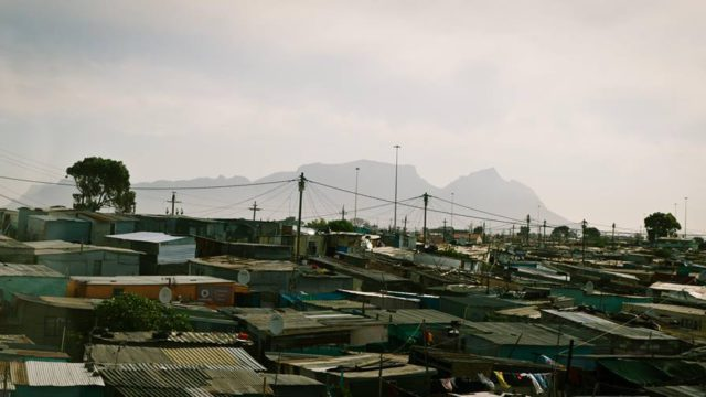 A photo of shacks and informal settlements in Khayelitsha in Cape Town, South Africa