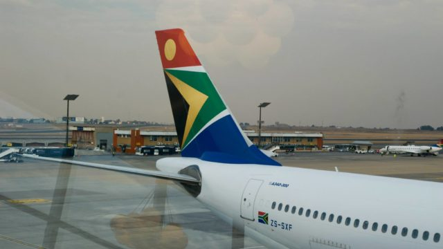 SAA flight. South African emigration.